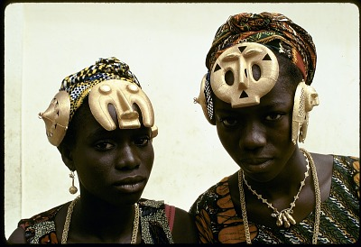 Katherine Ake Agouabe and Franc̦oise Dao Alouette wearing gold hair ornaments, Anna village, Ivory Coast. [slide]