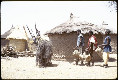 Drummers accompanying masked performers with male and female Chi wara headdresses, Bamako (national district), Mali. [slide]