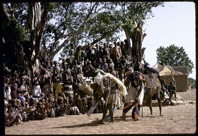 Three masked performers, one wearing male horizontal Chi wara headdress, the two others wearing double-headed horizontal Chi wara headdresses, both referred to as n'gonzon koun, Bamako (national district), Mali. [slide]