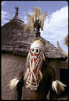 Masked performer wearing vertical Chi wara headdress, Bougouni village, Mali, [slide]