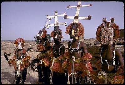 Kanaga and dyomo masqueraders during the Dama ceremony, Sanga, Mali. [slide]