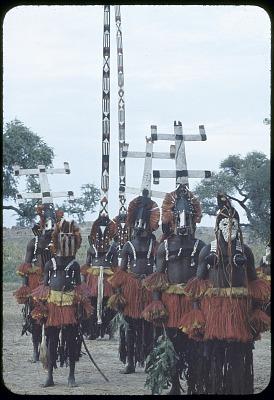 Sirige, Kanaga, Dyomo and Pulo Yana masqueraders during a Dama ceremony, Sanga, Mali, [slide]