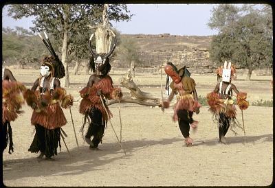 Dyomo, Danana, buffalo and Pulo Yana masqueraders during a Dama ceremony, Sanga, Mali, [slide]