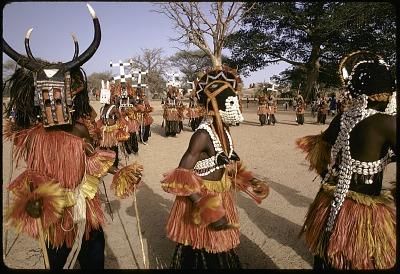 Kanaga, Dyomo, buffalo and Pulo Yana masqueraders during a Dama ceremony, Sanga, Mali, [slide]