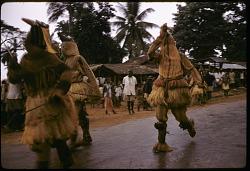 Igbo mask dancers performing during the Onwa Asaa festival, Ugwuoba village, Nigeria. [slide]