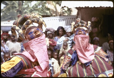 Pair of masked dancers during a Gelede performance, Meko, Nigeria, [slide]