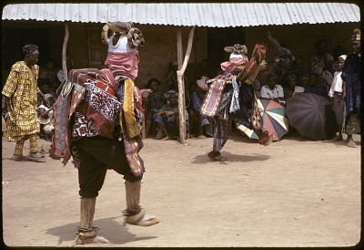Pair of masked dancers during a Gelede performance, Meko, Nigeria, [slide]