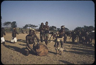 Musician accompanying Irigwe dancers of Miango village, Jos Plateau, Nigeria, [slide]
