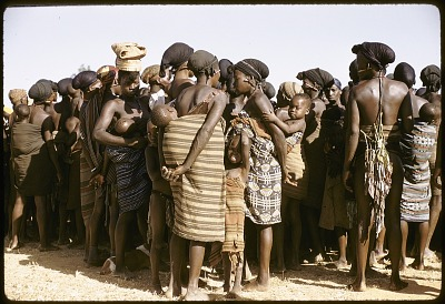 Irigwe women watching male dancers, Jos Plateau, Nigeria, [slide]