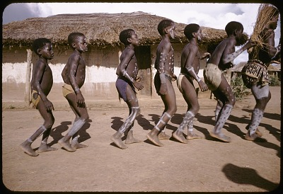 Dakpa boys, with white dots painted on their body, dancing at their initiaton rites, Ubangi-Shari region, Central African Republic. [slide]
