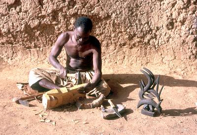 Blacksmith-sculptor producing vertical Chi wara headdress out of a solid mass of wood, Bamako region, Mali. [slide]