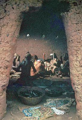 Nupe men around glass melting furnace, Bida, Nigeria, [slide]