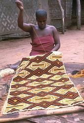 Kuba woman decorating woven cloth, Mushenge, Congo (Democratic Republic), [slide]