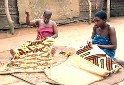 Kuba women decorating woven cloth, Mushenge, Congo (Democratic Republic), [slide]