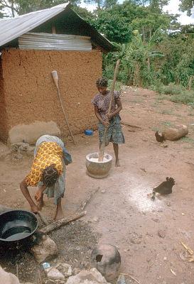 Yoruba women preparing meal, near Ife, Nigeria, [slide]