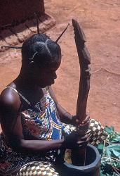 Mangbetu woman pounds manioc leaves, Medje village, Congo (Democratic Republic). [slide]