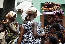 Woman carrying cloths on her head, Kumasi, Ghana, [slide]