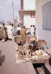Healer selling his wares on street corner, Lagos, Nigeria. [slide]