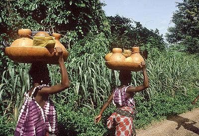 Yoruba women on their way to market carrying gourds, near Ibadan, Nigeria, [slide]