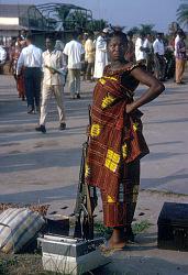 Woman holding two firearms on her side, Kisangani, Congo (Democratic Republic). [slide]