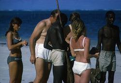Tourists on the beach, Mombasa, Kenya. [slide]