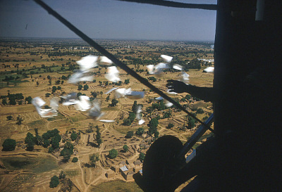 Political campaign leaflets being dropped from helicopter, at the Institute of Administration, Zaria, Nigeria. [slide]