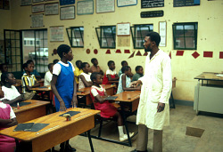 A teacher at work in a school sponsored by the Gécamines, a state-owned mining company, Kolwezi, Congo (Democratic Republic), [slide]