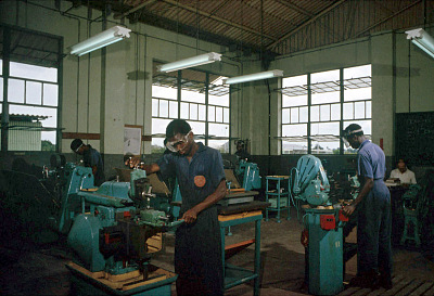 Students at Shell-BP Trade School in turning section doing exercises on lathes and shaper, Port Harcourt, Nigeria. [slide]