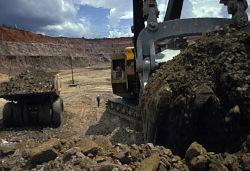 Shovel and 100-ton truck at work, Kamoto open pit copper mine, Kolwezi, Congo (Democratic Republic), [slide]
