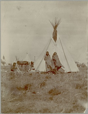Four Men Wearing Blankets outside Tipi Behind Them 1903