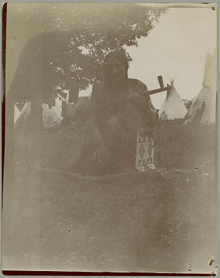 Man with Pipe and Beaded Bag outside Tipis 1903