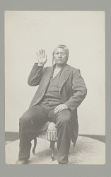 Portrait of Tendoi Demonstrating Sign Language n.d