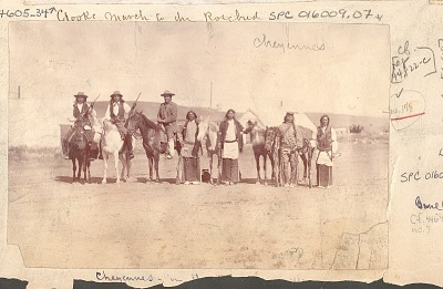 Seven Cheyennes, Some on Horseback, Others with Horses, All with Rifles; Tents in Background n.d