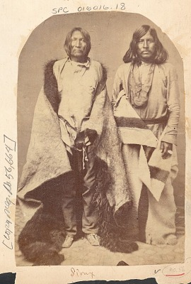 Portrait of Two Men (L-R: Poor Bear, Plains Apache; Jacob, Caddo) in Partial Native Dress, with Buffalo Skin Robe and Hudson Bay Blanket 1859