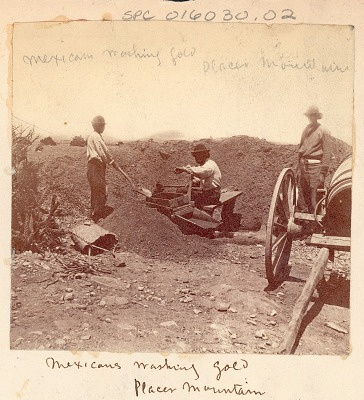 Three Mexican Men, Miners, Washing Gold in Screen; Two-Wheeled Cart Nearby n.d