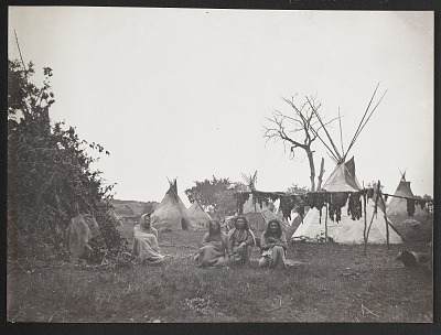 Three Indians and Horace P. Jones (Interpreter) ? in Front Of Meat-Drying Rack at Camp 1869