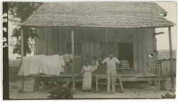 Photograph with Louisa and Will Jim, with Unidentified Girl, Outside Their Home 1925