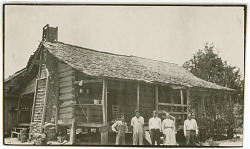 Jim Family (Isaac?, Will, David D, Martha, and Wilson) Outside Their Log Cabin 1925