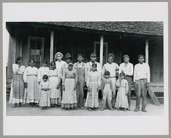 Group of 15 Men, Women, and Children with Indian Agent Mr Scott 1925