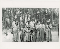 Group of 11 Men, Women, and Children with Indian Agent Mr Scott (Non-Native) 1925