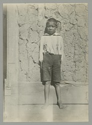 Young Boy on Porch of Adobe? and Wood House 1898