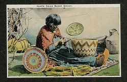 Woman in Native Dress, Weaving Basket; Other Baskets Nearby n.d