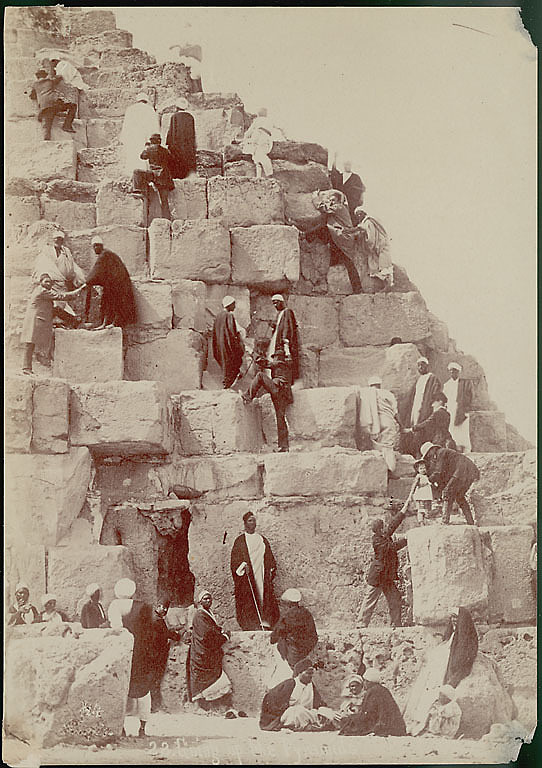 images for Group of Egyptian Men, Dragomans, Hauling Tourists, Non-Native Group, Up Stone Blocks to Top of Pyramid of Khufu (Cheops) (2551-2528 BC) or Great Pyramid 1868