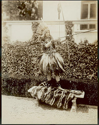 Abigail Pareus, Non-Native Woman, in Borrowed Costume And Ornaments from Various South American Peoples and Aiming Dart Beside Pool on Estate; Aiming Bow and Arrow n.d