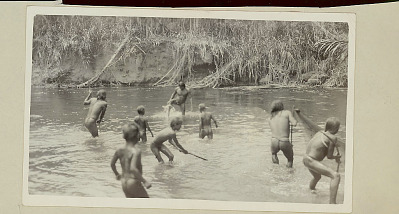 Choco Men and Boys Wearing Breechcloths and Fishing in River with Net and Spears 1923
