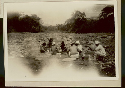Choco Men, Non-Native Expedition Members and Native Guide, Eating in Field of Rocks 1923