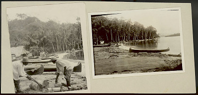 Two Cuna Men in Costume, Making Wood Stool? Using Stone Axe? And Machete on Beach; Dugout Canoes; Pole Houses with Thatch Roof In Background 1923