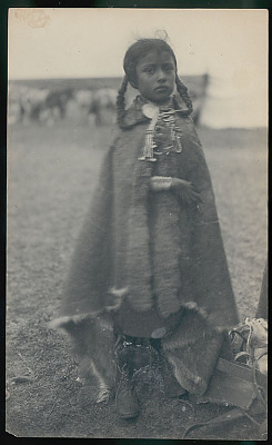 Girl Wearing Guanaco Robe and Ornaments in Camp FEB 1898