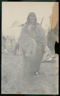 Old Man ? Wearing Guanaco Robe and Headband Outside Toldo (Skin and Pole Tent); Horses Nearby FEB 1898