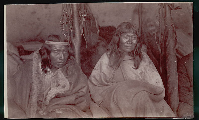 Chief (Part Afro) Wearing Guanaco Robe and with his Wife, Both in Costume Inside Toldo (Skin and Pole Tent); Horse Trappings And Bola Hanging on Poles 02 FEB 1898